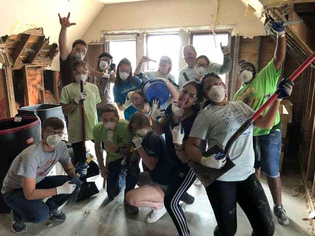 group of students volunteering abroad