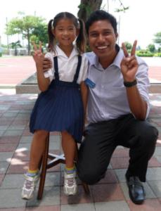 Bijeysh Ranji featured kneeling next to an elementary school girl
